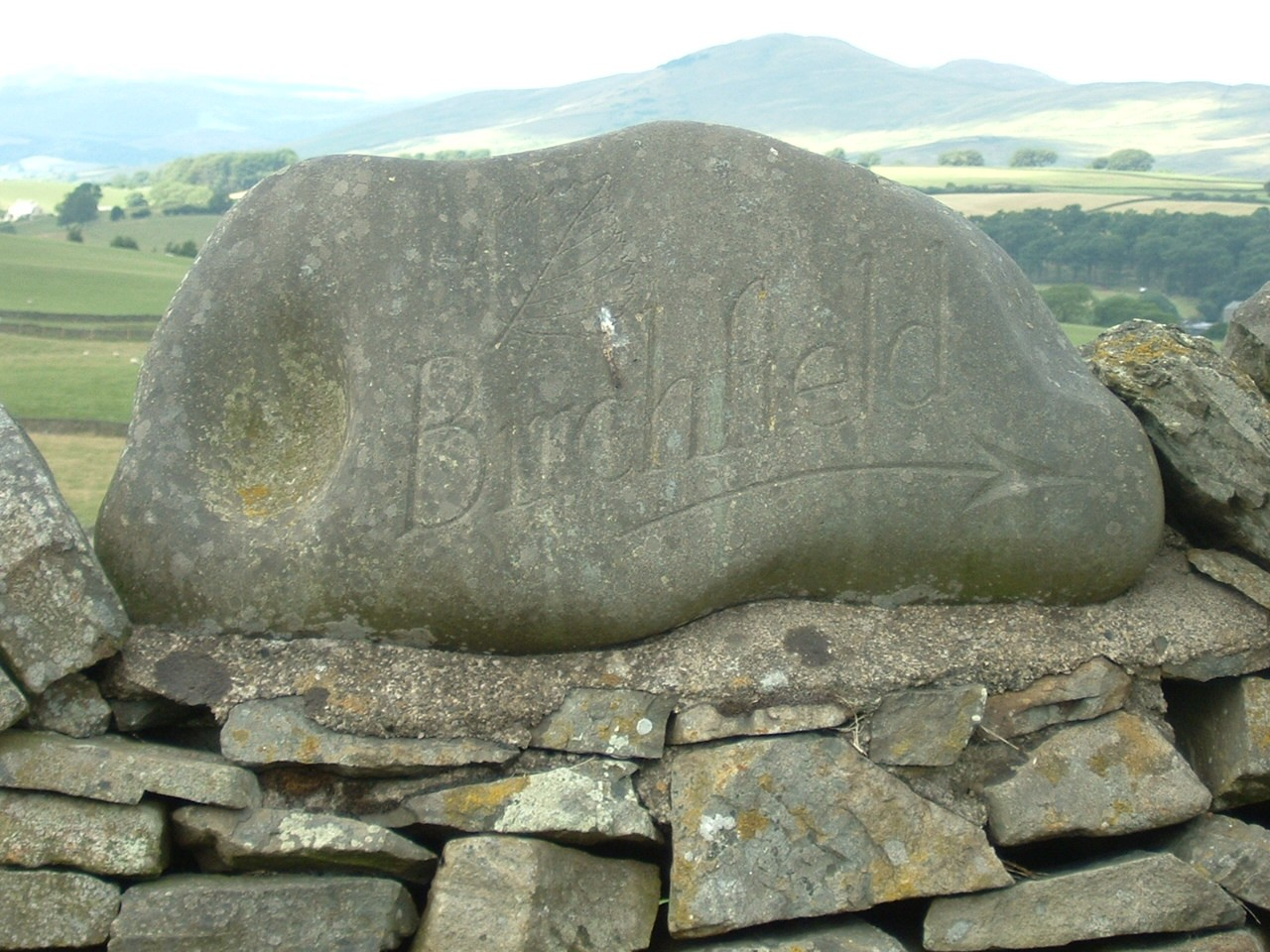 Boulder Stone Name Plate designed to be fit on top of the wall.