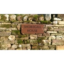 Rectangular Sandstone Name Plate with 2 inch engraved letters, painted black. Designed to be attached to a wall.