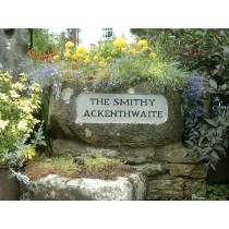 Boulder Stone with detailed area Name Plate designed to be fit on top of the wall.