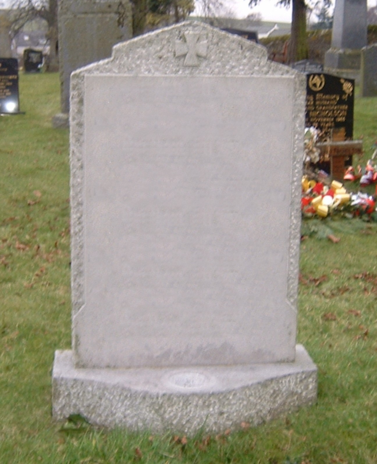 PJ16 - UK sourced limestone this memorial is made in our workshop in Kendal to client's instruction shape, finish and lettering style.  Bespoke Headstones, Lawn Memorials