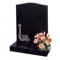 RL199 - Black granite with an o-gee top contrasts the book and candle design. Lawn Memorial, Headstone