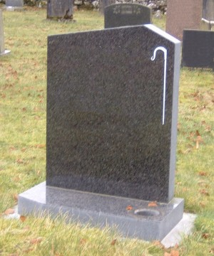 PJ13 - Off set peon in Dark grey granite shown here with a shepherds crook. Lawn Memorial, Headstone