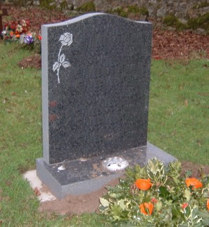 PJ15 - The simple rose design compliments the o-gee shape to this dark grey granite memorial. Lawn Memorial, Headstone